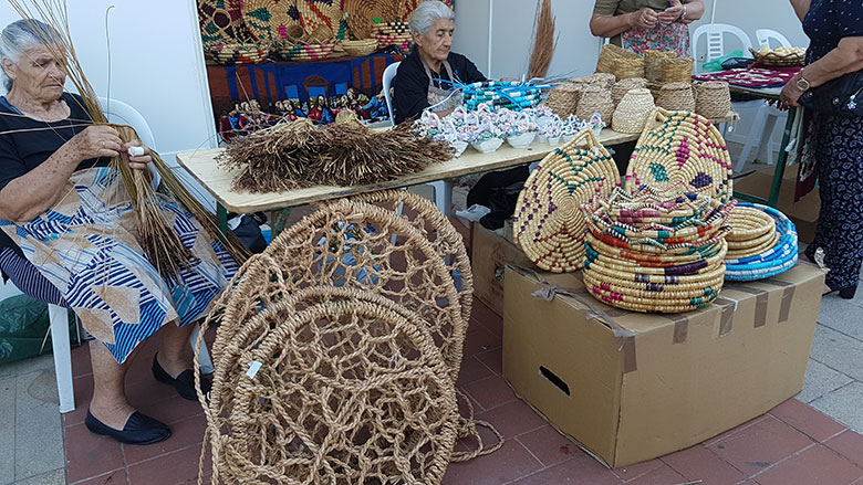 OLD WOMEN MAKING TRADITIONAL CYPRIOT WOVEN BASKETS