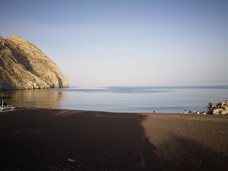Black sand beach in Santorini - Perissa
